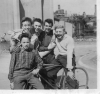 Stan Allison astride bike with team mates at Arbour Square, Stepney Sunday May 10 1953.
